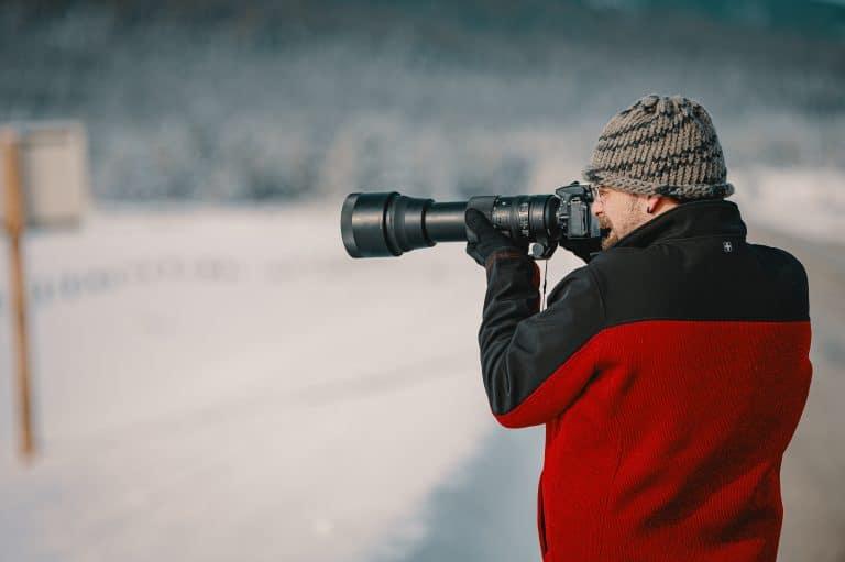 Man shooting landscape