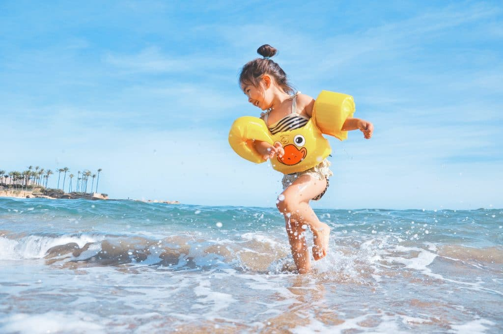Girl kid playing on a beach - Child Photography