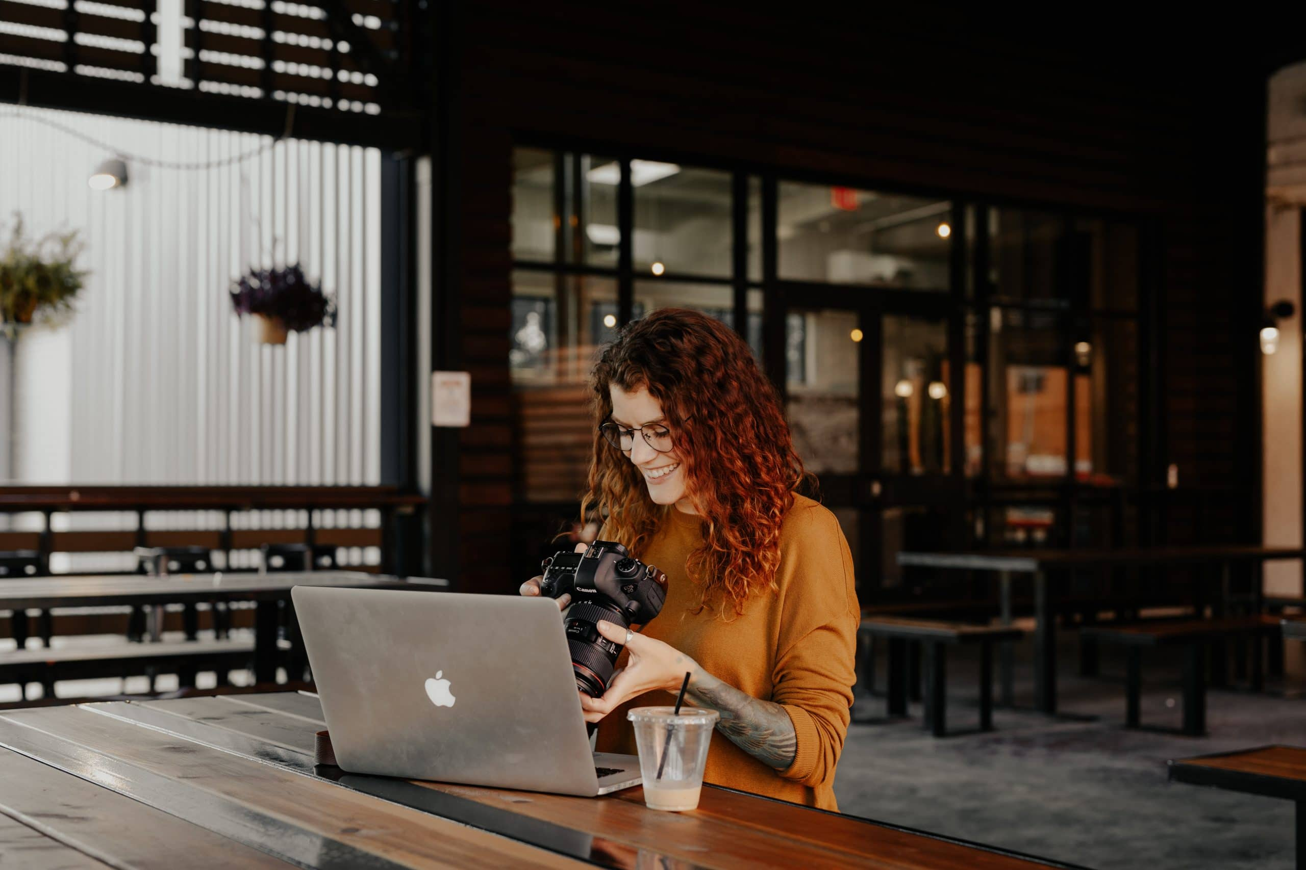 Woman editing photos - How to batch edit in Lightroom