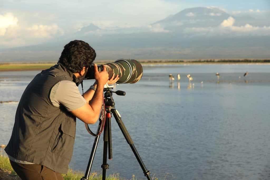 Photographer with camera - Best Wildlife Photography Lenses 2021