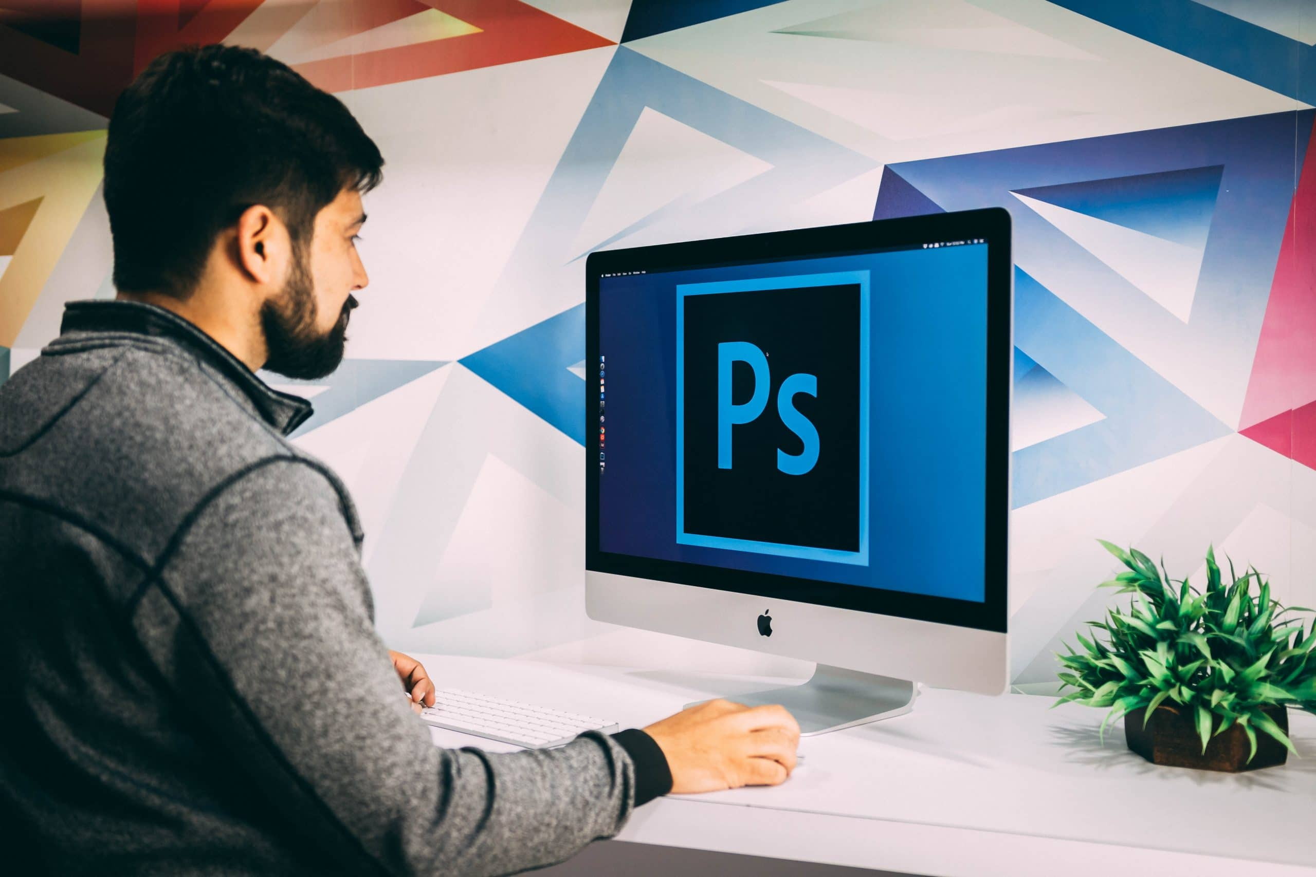 Man using Photoshop - How to Remove an Object in Photoshop