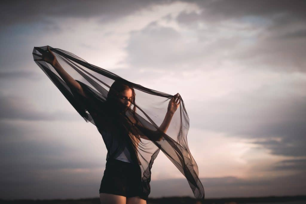 Girl with a scarf adding Visual Weight in Composition