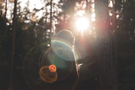 How to add lens flare in a photo of Girl in the woods