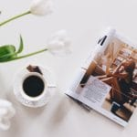 Magazine with plant and cup - What is Editorial Photography