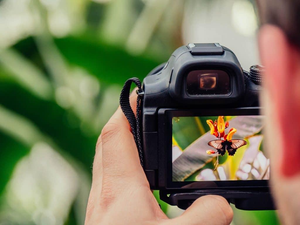 Man using a camera - Camera Metering Modes