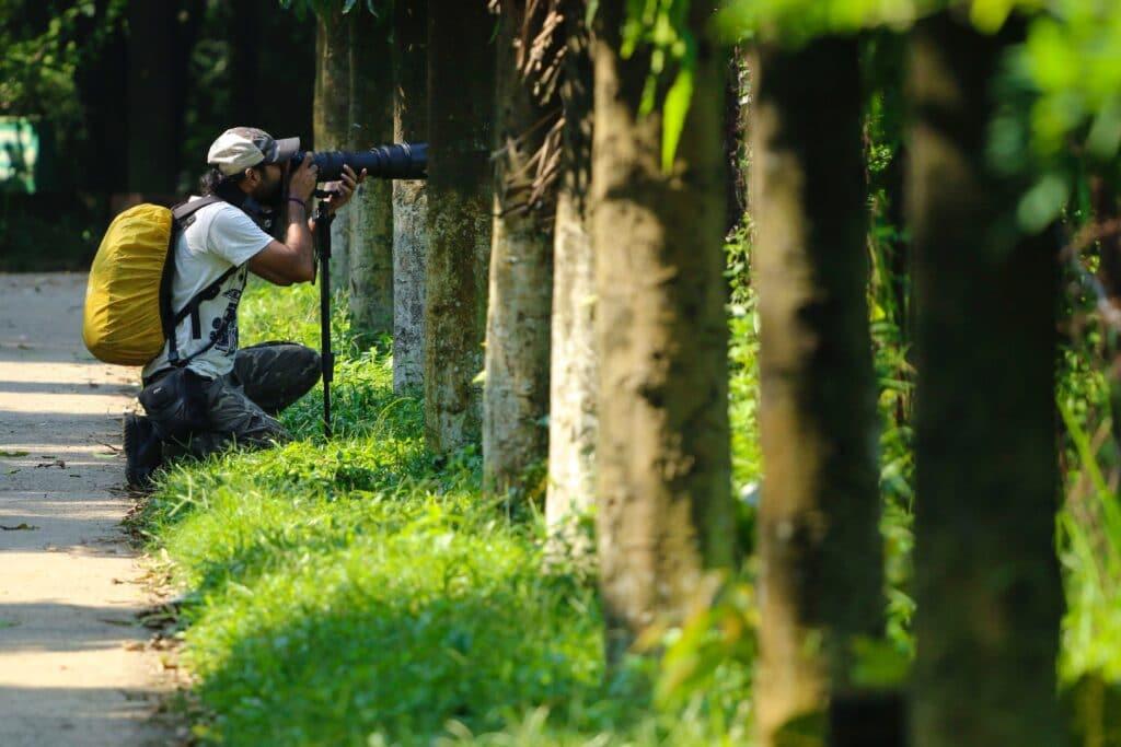 Bird Photographer using wildlife photography equipment
