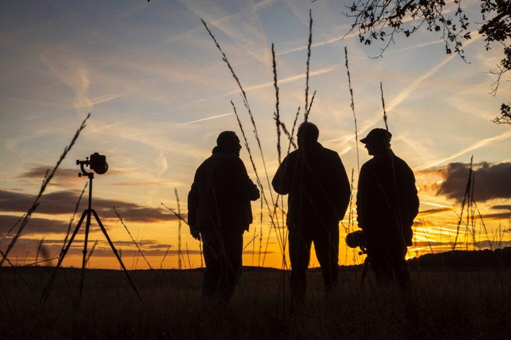 Group of wildlife photographer using wildlife photography equipment