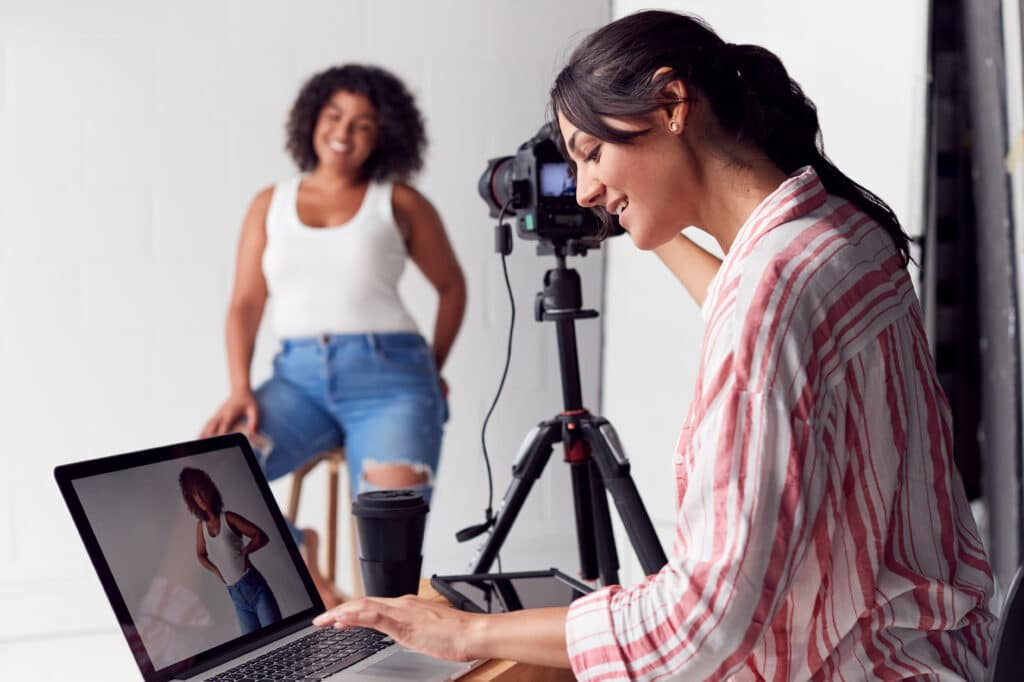Female photographer using camera tethering